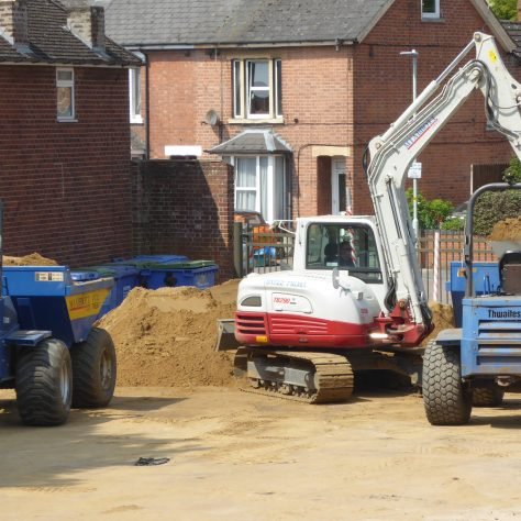 The operator takes one load to the pitch area whilst the other dumper truck is reloaded.