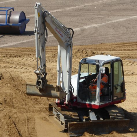 With the bulldozer temporarily out of action the plough on the excavator is brought into use to shift the sand.