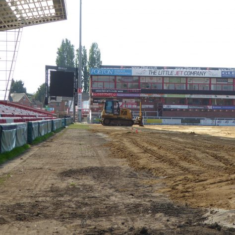 The level of the new pitch will be several inches above the level of the old pitch.