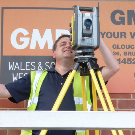 The surveyor sets up the GPS system which will be used to check and set the levels of the ground.
