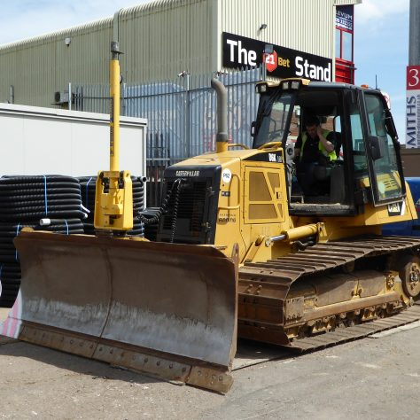 The GPS controlled bulldozer which will smooth out the surface.