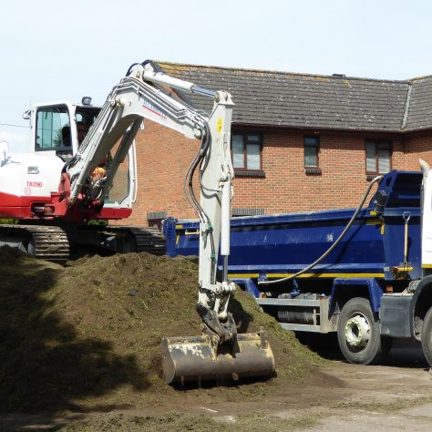 An estimated 200 tons of soil and grass clipping being removed to Hartpury.