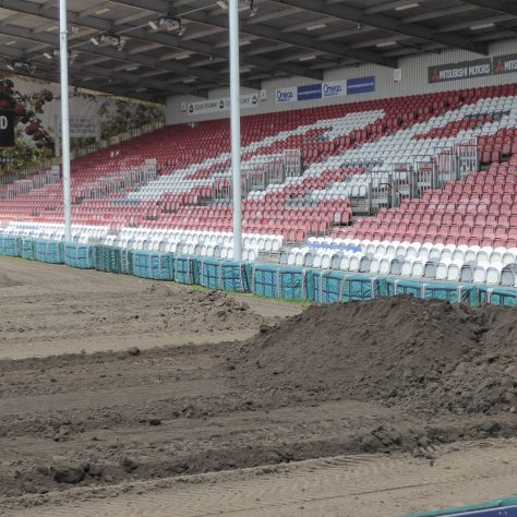 Soil piled up at the end of the run.   None of the soil leaves the site.  It's all being redistributed around the pitch.