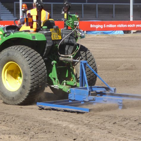 Creating a smooth surface with a tractor drawn harrow