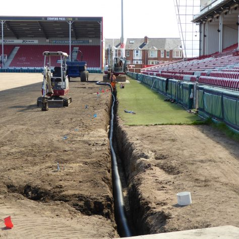 The main drainage pipe nearing completion along the south side of the ground.
