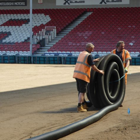 The second 50m length of 150mm pipe being rolled out ready for installation.