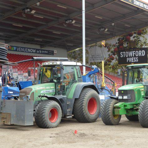 Three tractors working in unison.