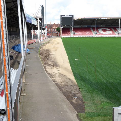 An area to the side of the pitch alongside the Shed is left uncovered.