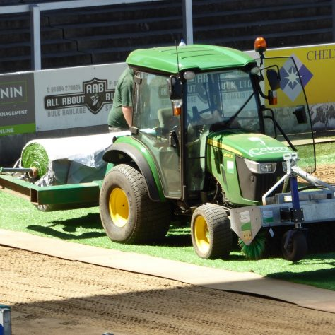 From time to time the tractor is reassigned to lay more mat just in front of the main grandstand.