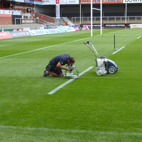 Setting up the laser system before marking out the 5 metre line.