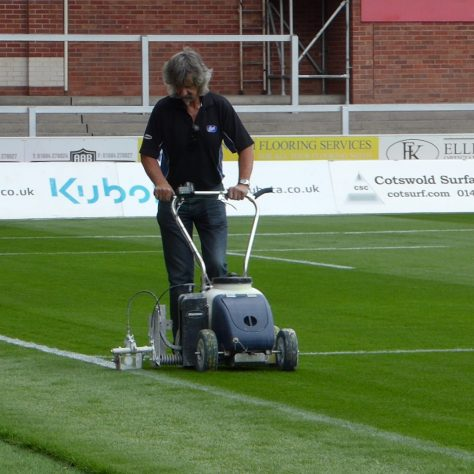 Lining the touchline.