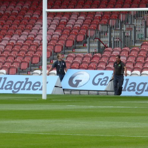 Positioning the Gallagher advertising wedges at the eastern end of the pitch.