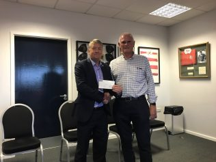 Nick Broady receives a cheque on behalf of Pied-Piper