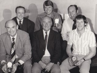 Peter Ford (front row left) together with Dick Smith (front row right) and Alan Brinn (back row centre) with the clocks presented by the club to mark their 500 appearances