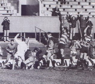 Bob Clewes, hidden under a mound of bodies, scores the winning try in the 1978 semi-final