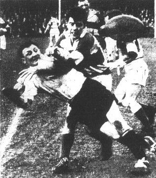 Denis Ibbotson gets his pass away. Gloucester v Pontypool March 1959. Owing to the clash of colours Gloucester played in white shirts   Citizen