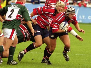 Taking on Leicester: Andy Hazell with the ball, supported by Jake Boer