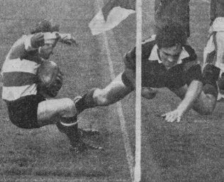 Dix turns inside Griffiths's flying tackle to score Gloucester's opening try Twickenham 1972
