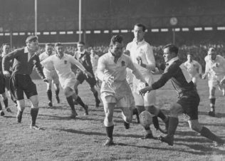 Price (centre) goes for the ball England v Wales Twickenham 1949